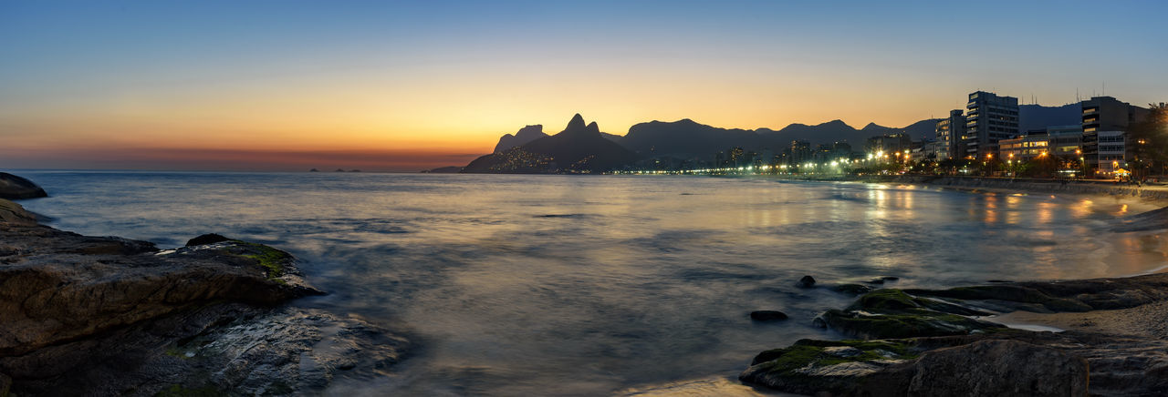 Panoramic image of Ipanema beach at dusk Hills Nature Panorama Skyline Architecture Beach Beauty In Nature Building Exterior City City Lights Clear Sky Dusk Nature Outdoors Pamoramic Rock - Object Scenics Sea Sea And Sky Seascape Sky Summer Sunset Travel Destinations Water