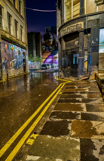 moody Glasgow Mitchell Street with mural art from Smugone and Rougue-one Glasgow  Scotland Uk United Kingdom Moody Mural Art Streetart Neon City Illuminated Wet Architecture Sky Building Exterior
