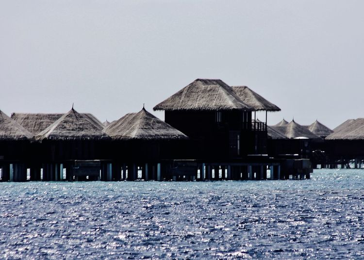 Water Village in Indian Ocean, Maldives Architecture Blue Built Structure Clear Sky Colors Fine Art Holiday Indian Ocean Light Maldives Nature Ocean Outdoor Outdoors Relaxing Sea Shillouette Sky Stilt House Thatched Roof Travel Vacations Village Watervillage