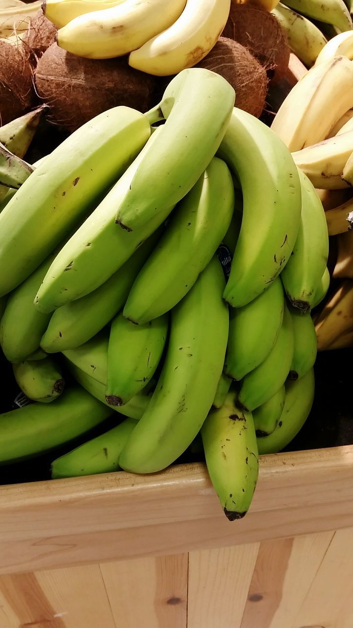 High Angle View Of Bananas In Container At Market For Sale
