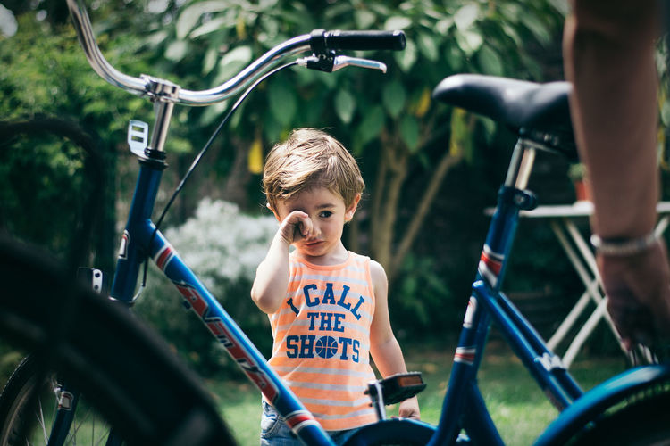 Bicycle Boys Casual Clothing Childhood Day Leisure Activity Lifestyles One Person Outdoors People Real People Text Transportation