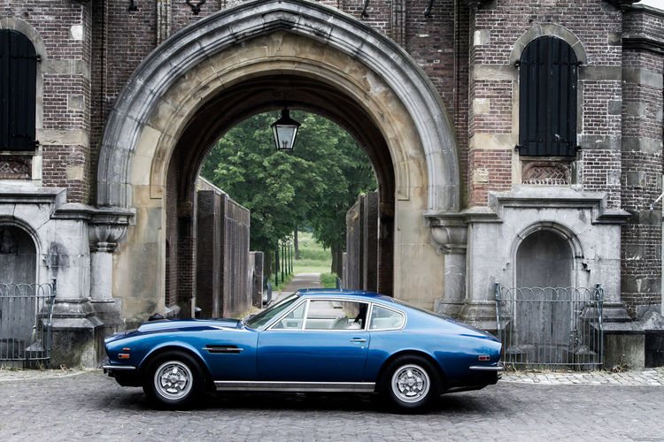 Aston Martin V8 in Naarden, The Netherlands Aston Martin Astonmartin Blue British Car Car James Bond Jamesbond Oldtimer Supercar Supercars Cars Capital Millionaire Millionnaire 007 Collector's Car Luxury Sports Car Classic Car Sportscars Sportscar Vintage Cars Classic Cars Youngtimer Wealth