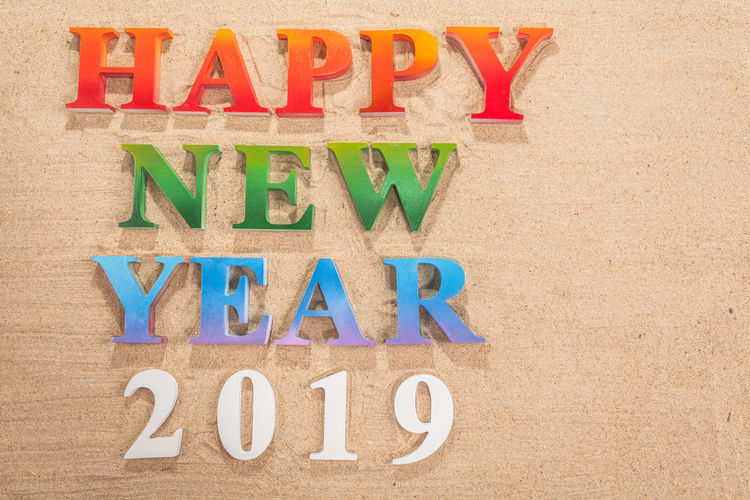 colorful of alphabet happy new year 2019 on the beach decorate with shells with copy space 2019 Year Alphabetography Text Alphabet Beach Capital Letter Communication Font Happy New Year High Angle View Indoors  Letter Multi Colored No People Text Western Script