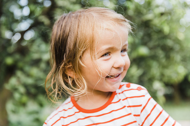 Toddler girl portrait in garden - Cirali, Antalya Province, Turkey Beautiful Beauty Blond Blue Eyes Caucasian Cheerful Child Childhood Close-up Content Curiosity Cute Enjoyment Environment Face Forest Fun Garden Germany Girl Green Growth Hair Happy Headshot Innocence Joy Lifestyle Nature One Outdoors People Portrait Preschool Smiling Standing Striped Summer T-shirt Toddler  Toothy Tousled Tree Watching Wet WoodLand Woods Real People One Person Focus On Foreground Girls Leisure Activity Casual Clothing Day Females Lifestyles Blond Hair Mouth Open Hairstyle The Portraitist - 2019 EyeEm Awards