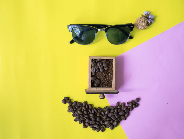 Close-up of sunglasses on table against wall
