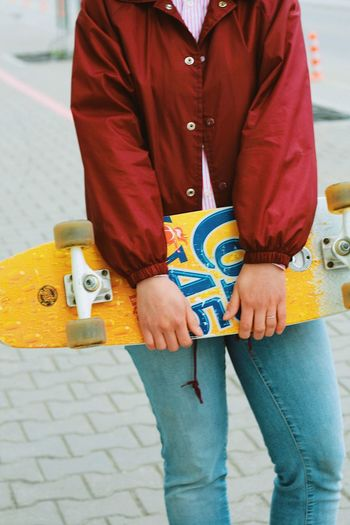 Skateboard Skateboarding Skateboard One Person Adult Human Body Part Men Clothing Casual Clothing Real People Street Women Traditional Clothing Lifestyles Body Part Low Section Day Midsection Front View Standing Yellow Skate Photography: Same Tricks, New Perspectives
