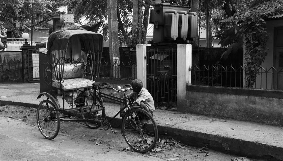 The rickshaw and its master! Showcase April Candid Candid Photography Hot Summer Day Hunger Lonely Road Outdoors Parked Rickshaw Rickshaw Puller Rickshaw Wallahs Roadside Tired Man Waiting