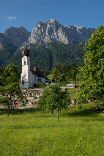 Holidays in bavaria Bavarian Landscape Architecture Bavarian Alps Bavarian Church Bavarian Nature Beauty In Nature Building Building Exterior Built Structure Day Grass Green Color Land Mountain Mountain Range Nature No People Outdoors Plant Religion Scenics - Nature Sky Sunlight Tree
