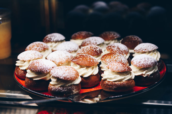 """Swedish seasonal delight """" Semla """" or with its old name Hetvägg Dessert Fika Fika Time Semla Swedish Cuisine Cafe Cafeteria Close-up Cupcake Day Dessert Focus On Foreground Food Food And Drink Freshness Indoors  Indulgence No People Ready-to-eat Swedish Food Swedish Semla Sweet Food Table Temptation Unhealthy Eating"""