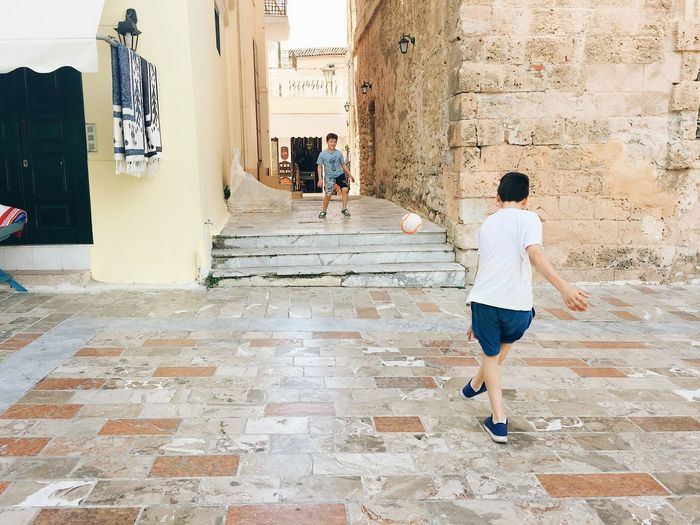 Boys playing football in Nafplio, Greece Children Football Greek Summer Kids Kids Playing Nature Travel Childhood Childhood Memories Greece Joy Kids Having Fun Kids Playing Football Nafplio Playing Playing Football Street Fun Travel Destinations