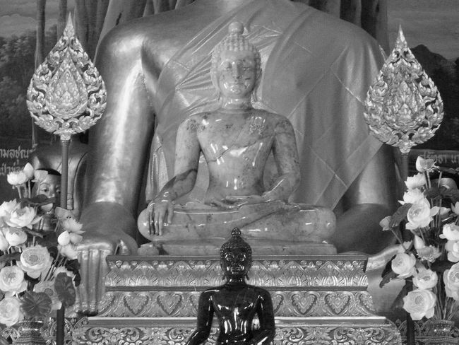 In a temple of south-east of Asia 3 Buddhas Black & White Buddhas Three Buddhas Art And Craft Buddhastatues Idols Indoor Photography Lotus Flowers Spirituality Statue Front View Bnw Horizontal Photography