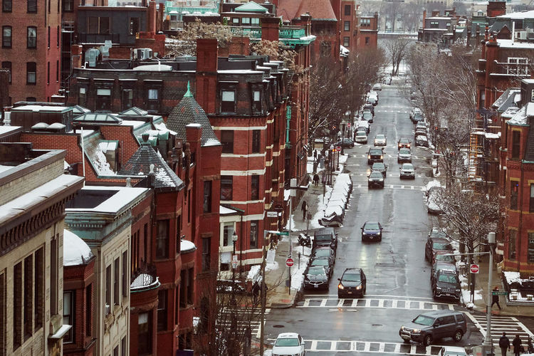 High angle view of street amidst buildings in city during winter