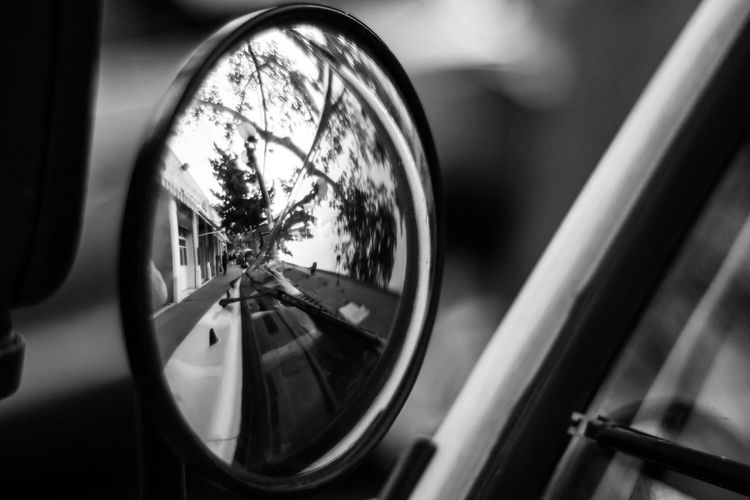The Street Photographer - 2017 EyeEm Awards Reflection Car Close-up No People Black And White Photography Black And White Collection  Bnw_society Bnw_worldwide Mirrors Fisheye BYOPaper!