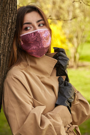 Portrait of woman covering face with eyes closed
