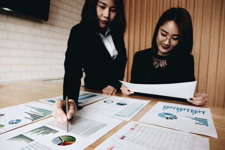 Businesswomen working on table