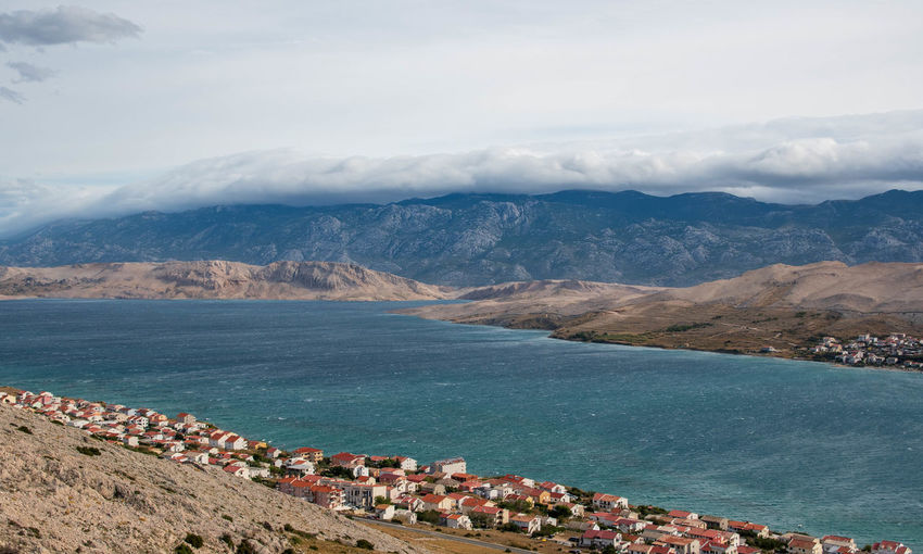 Scenic view of bay of sea, town, mountains. sky and clouds, seascape, landscape.
