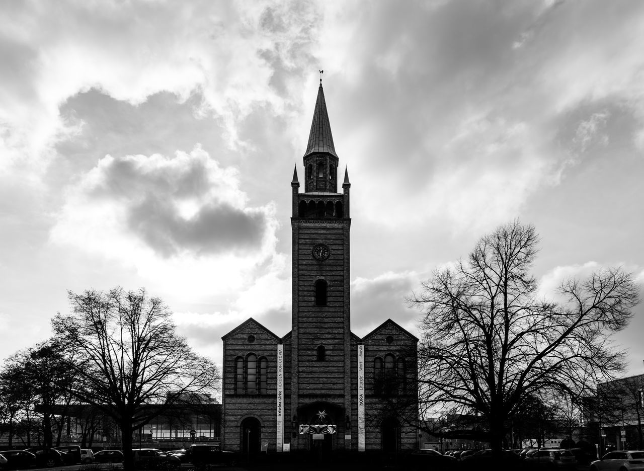 building exterior, built structure, architecture, sky, building, tree, cloud - sky, religion, place of worship, belief, plant, tower, bare tree, spirituality, nature, no people, day, spire, outdoors