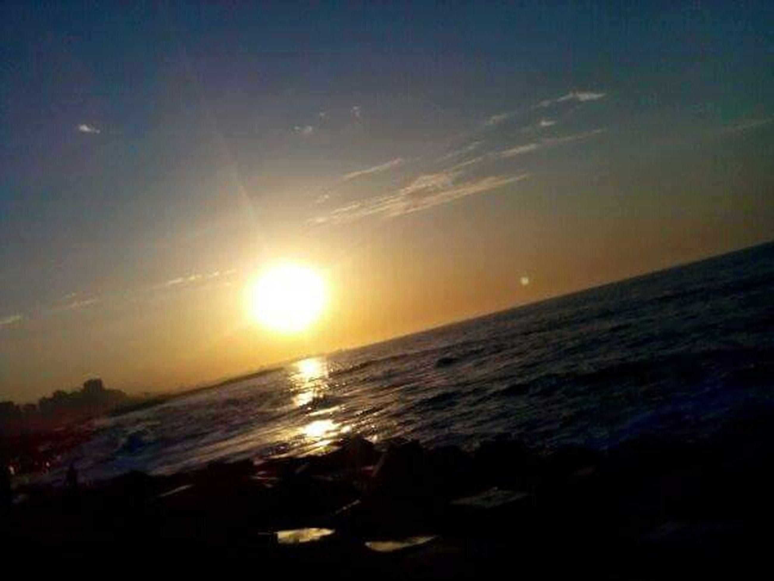 sunset, sea, sun, horizon over water, water, scenics, tranquil scene, beauty in nature, tranquility, sky, idyllic, orange color, nature, beach, reflection, sunlight, shore, sunbeam, outdoors, seascape