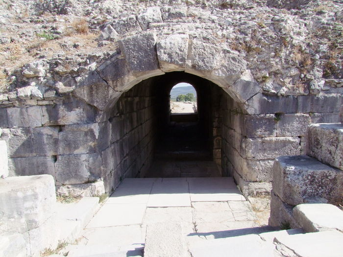Tunnel to Theatre, Miletus Ancient Ruins Arch Arched Architecture Archway Building Exterior Built Structure Composition Day Entrance Feature Full Frame History Light At The End Of The Tunnel Miletus Old Old Ruin Outside Photography Stone Material Stone Wall Sunlight The Past Theatre Tunnel Turkey