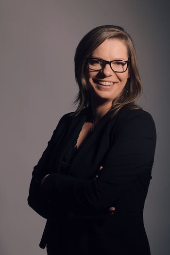 Portrait of a business woman Eyeglasses  Glasses Smiling Young Adult One Person Looking At Camera Young Women Portrait Happiness Hairstyle Indoors  Waist Up Standing Real People Arms Crossed Hair Women Front View Beautiful Woman