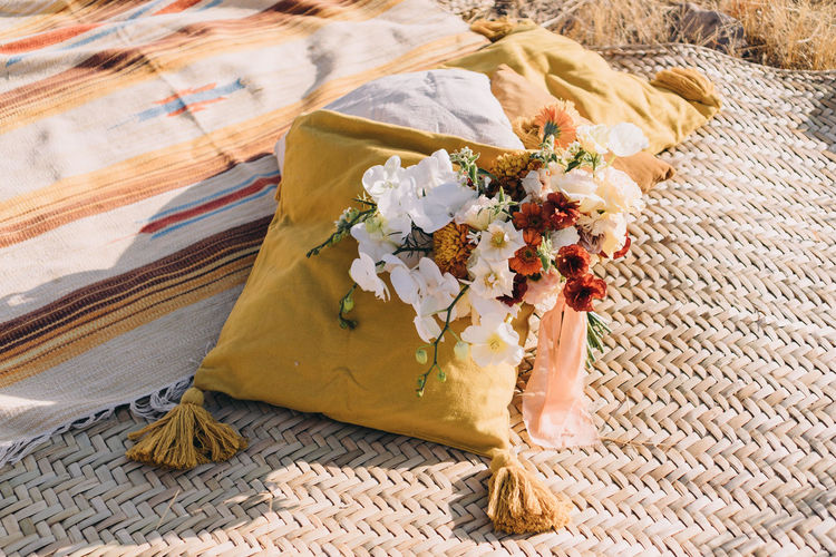 High angle view of flower bouquet on pillows