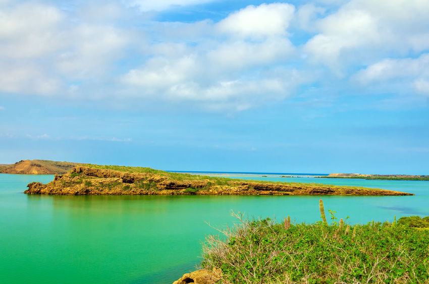 View of several islands in the Caribbean Sea near Punta Gallinas in La Guajira, Colombia Beach Blue Caribbean Colombia Green Guajira Idyllic La Guajira La Guajira Colombia Landscape Natural Nature Punta Gallinas Sand Sea Seascape Season  Sky Summer Sunlight Sunshine Tranquil Tropical View Water