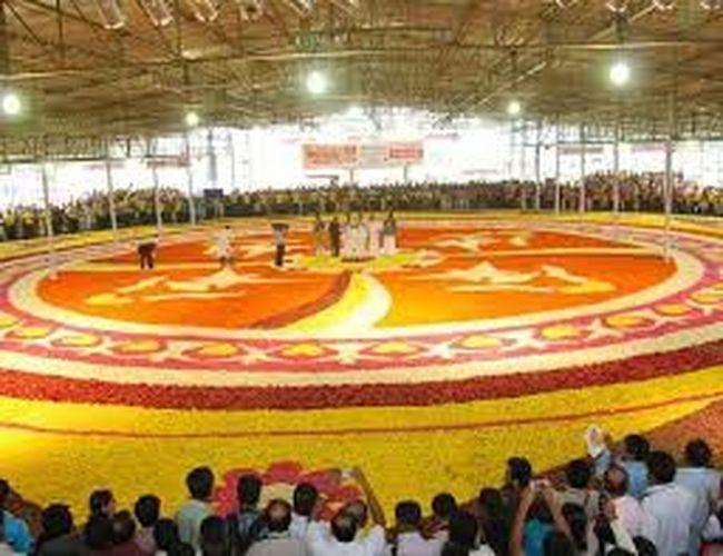 It is a HUGE FLOWER DECORATION done by Kerala women Stadium