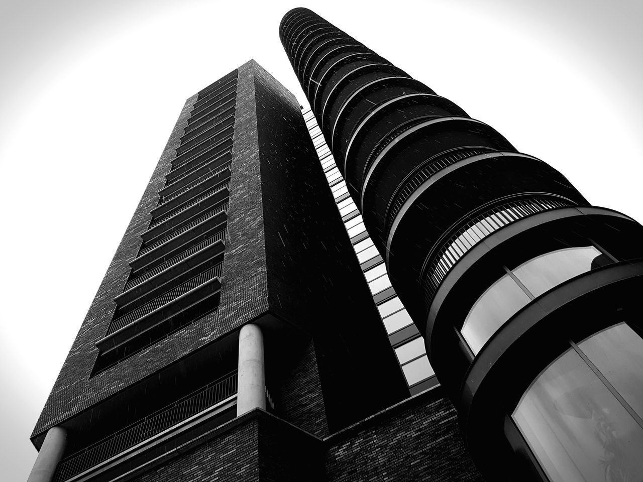building exterior, built structure, low angle view, architecture, no people, building, sky, clear sky, city, office, nature, day, tall - high, outdoors, tower, modern, office building exterior, pattern, repetition, industry, skyscraper