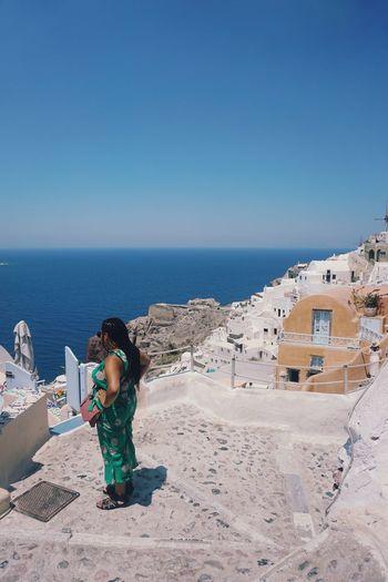 Female tourists enjoying the view of oia