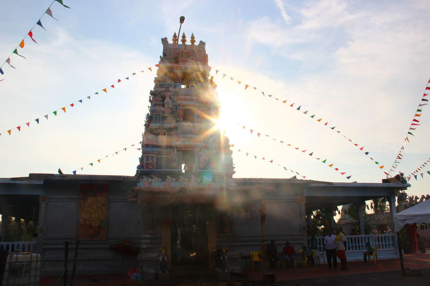 Architecture Building Exterior Built Structure Bunting Celebration Cloud - Sky Crowd Day Flag Indian Celebration 🎉 Large Group Of People Lens Flare Low Angle View Malaysia Men Outdoors People Place Of Worship Real People Religion Sky Spirituality Sunlight