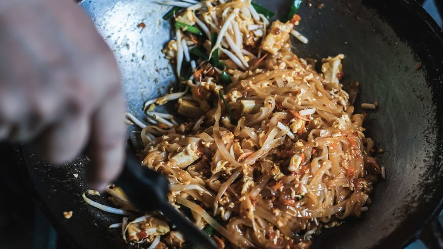 High angle view of food on cutting board.pad thai