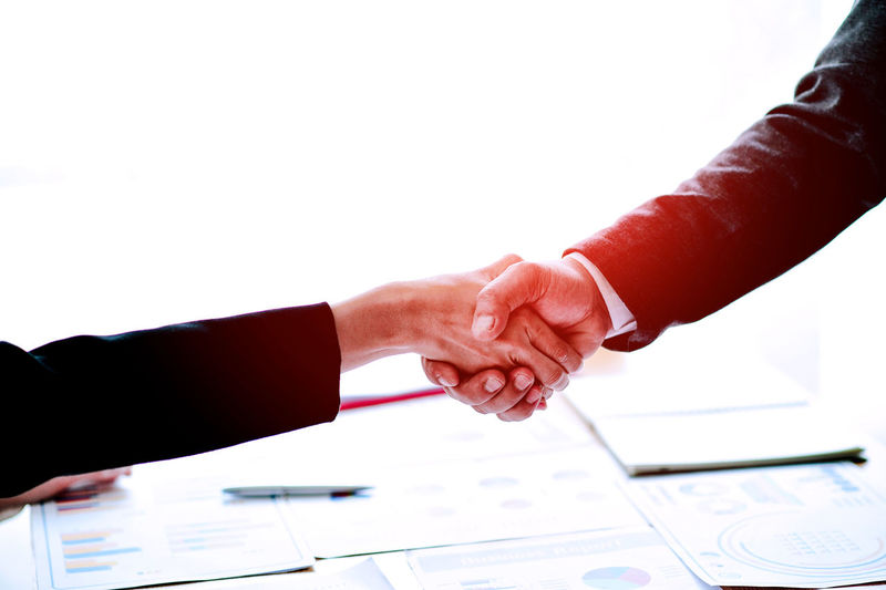 Adult Agreement Business Cooperation Copy Space Finger Gesturing Hand Handshake Human Body Part Human Finger Human Hand Human Limb Indoors  Meeting Men Partnership - Teamwork People Teamwork Two People White Background