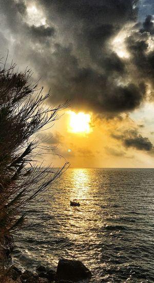 Sunset Sky Water Cloud - Sky Beauty In Nature Sea Scenics - Nature Tranquility Tranquil Scene Horizon Over Water Nature Sunlight No People Silhouette Sun Idyllic Horizon