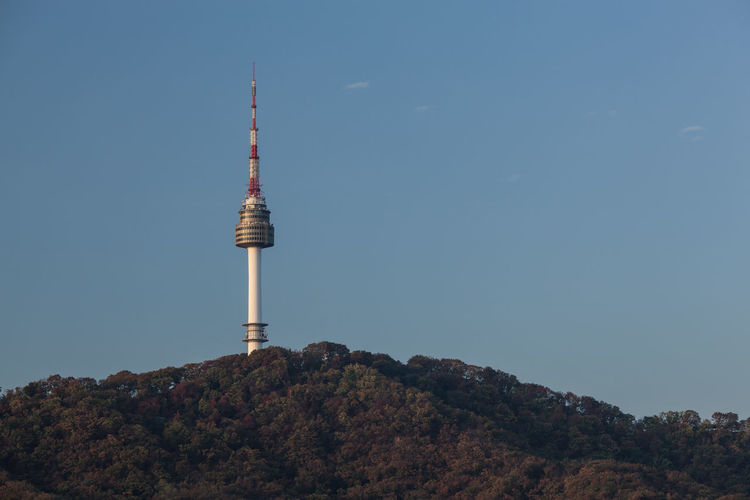 View to N Seoul Tower dominating over forested hill. It is a communication and observation tower in city center at 236 m height. South Korea Antenna - Aerial ASIA Communication Day High Hill Horizontal Landmark Namsan No People Outdoors Seoul Sky South Korea Spire  Technology Telecommunications Equipment Television Television Industry Tower Tree