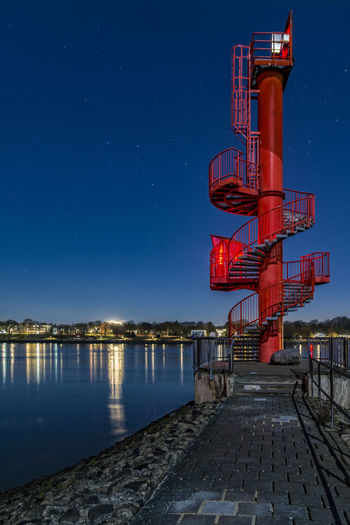 flare Astrology Sign Astronomy Blankenese Panorama Blue Sky Business Finance And Industry Elbe River Finkenwerder Flare Light Signal Nature Night Night Photography No People Outdoors Red Light Signal Sky Space Spiral Stairs Star - Space Stars Water Reflections