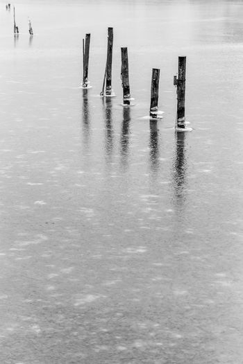 Low section of wooden posts in lake