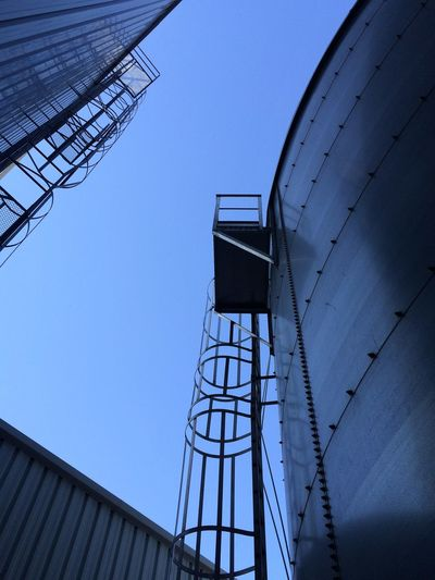 Architecture Blue Clear Sky Diminishing Perspective Insdustrial Low Angle View Strairs Tall Way Down Way Up Industrial Photography Turning Ugliness Into Beauty