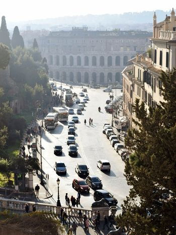 Leading to the Colosseum. Road Rome Colosseum City Tree Cityscape History High Angle View Statue Sky Architecture Amphitheater Old Ruin Vehicle
