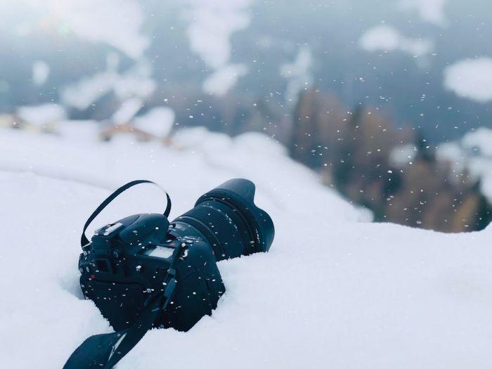 Close-up of camera on snow