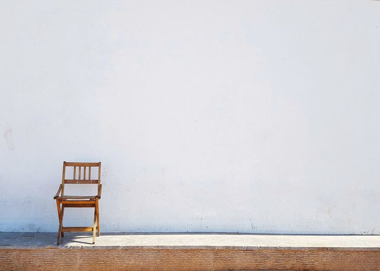 Lonely Chair Wooden Chair In Front Of White Wall Wooden Chair No People No Filter Lonelyness White Wall