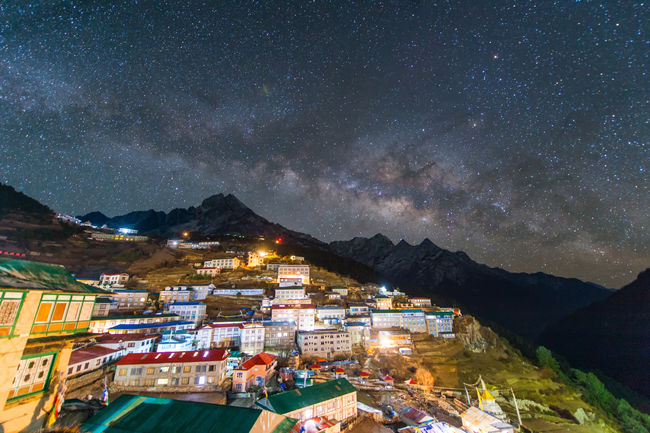 Namche Bazaar Architecture Astronomy Beauty In Nature Building Building Exterior Built Structure City Everest Base Camp Trek Galaxy House Illuminated Lukla Airport Mountain Mountain Range Namchebazaar Nature Night No People Outdoors Residential District Scenics - Nature Sky Space Star - Space