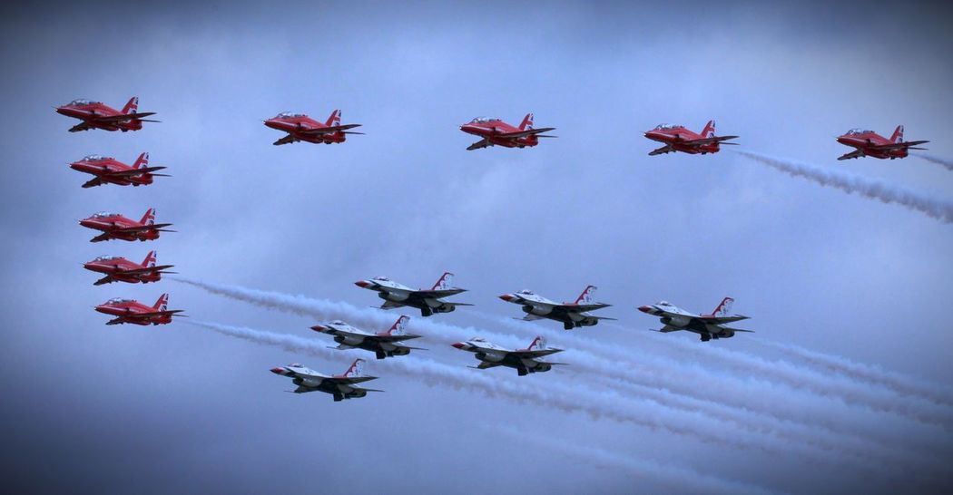Red Arrows & Thunderbirds United States Air Force Royal Air Force Thunderbirds F16 Fighting Falcon Low Angle View Flying Airplane Day Sky Outdoors Air Vehicle