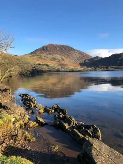 Lake End At Ennerdale Water In The Lake District Cumbria Crag Fell Ennerdale Water Cumbria Winter Mountain Scenics Nature Tranquil Scene Beauty In Nature Tranquility Lake Landscape Mountain Range Water Day Outdoors No People Sunlight Clear Sky Sky Tree