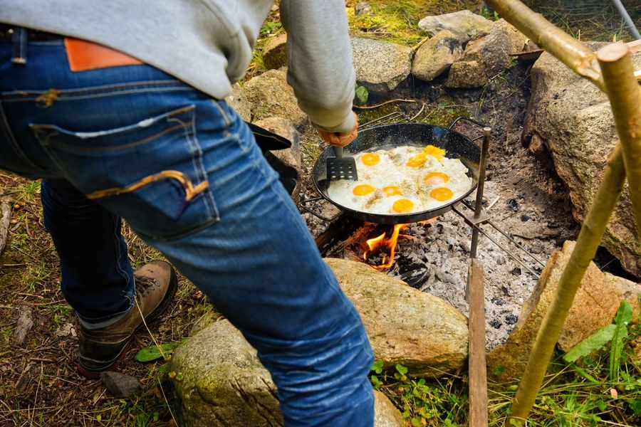 Breakfast Campfire Fried Egg Morning Casual Clothing Egg Fire Food Food And Drink Getting Away From It All Getting Inspired Men One Person Outdoors Preparation  Real People The Great Outdoors - 2018 EyeEm Awards