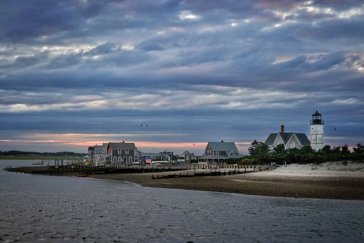 Provincetown Ocean Seascape House By The Sea House By The Water Beaches Cape Cod Sailing Boat Cluttered Overcast Sunset Dusk Cityscape City Beach Sunset Water Sea Sky Building Exterior Architecture Cloud - Sky Lighthouse Romantic Sky Shore Sand Sandy Beach Sand Dune Coast