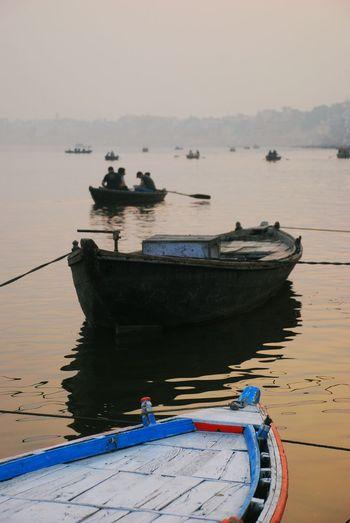 Boats on ganges river at sunset