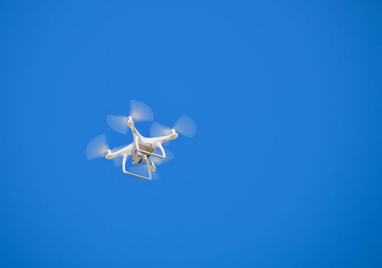 Drone flying in the clear blue sky
