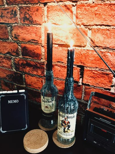 Candle Bottle Candlestick Holder Old Memo Horeca Cafe Candlelight Candle Bottle Brick Wall Captainmorgan Oakheart Alcohol Wall Drink Table Glass - Material First Eyeem Photo