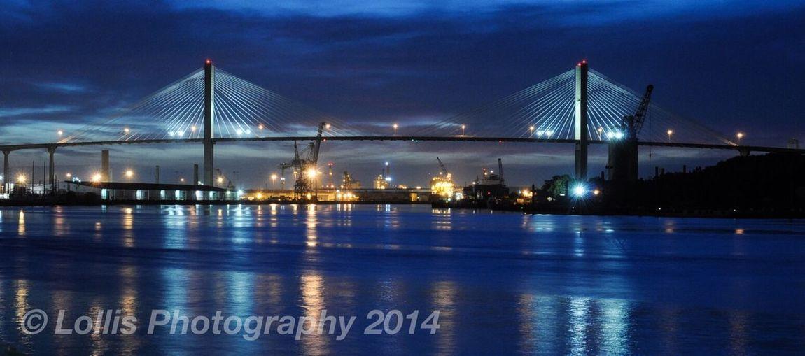 Talmadge Bridge crossing the Savannah River in Savannah Georgia at night from Riverstreet
