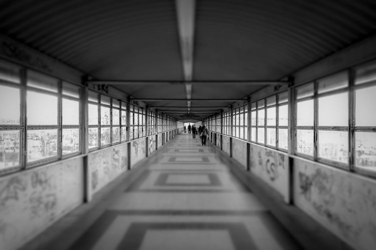 Black And White Black & White Street Photography Streetphoto_bw Footbridge Tilt-shift Tiltshift Urban Tristesse The Way Forward Direction Architecture Diminishing Perspective Built Structure Indoors  Day No People Ceiling Transportation Arcade Empty Corridor vanishing point Building Selective Focus Lighting Equipment Footpath Architectural Column